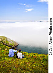 Father and son at ocean coast - Father and son looking at...