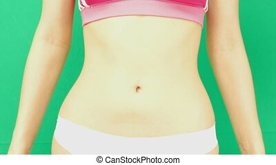 Perfect woman belly isolated on  hromakey background.