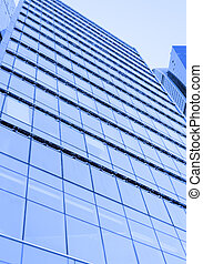 Perspective wide angle view to blue glass building...