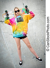 Blond Skater Girl - Pretty blond skater girl holding...
