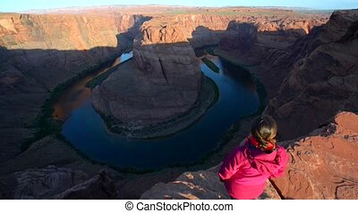 Girl Hiker Standing at the edge of Horseshoe Bend Page...