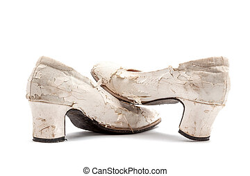 worn out shoes - an pair of worn dirty ladies shoes in white