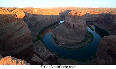 Horseshoe Bend Page Arizona at Sunrise slow pan left -...