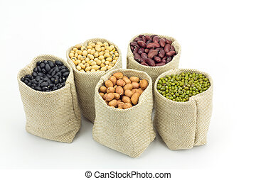 Different kinds of beans in sacks bag isolated on white...