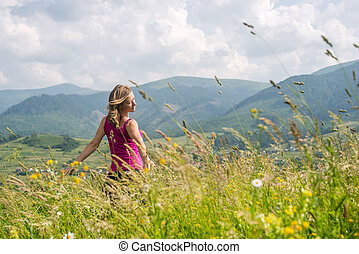 Woman staying at the Mountains - Blonde Woman staying at the...