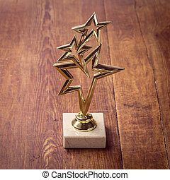 Star award with space for text on wood background