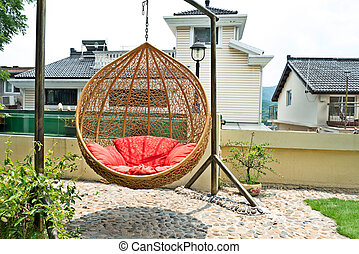 rattan hanging chair in garden