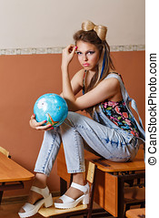 Wild Child in geography class with globe. - Tearaway is...