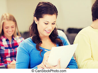 group of smiling students with notebook