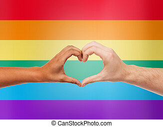 human hands showing heart shape over rainbow - people, gay...