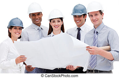 A diverse group of architects holding a blueprint looking at...