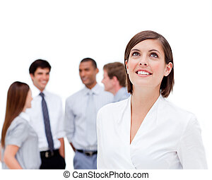 Cheerful manager in front of her team against a white...