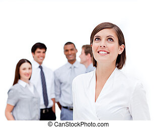 Happy manager in front of her team against a white...