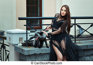 Girl with a fox on the balcony The girl black dress with...