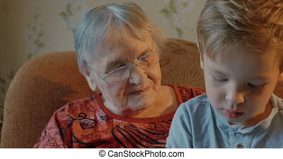 Grandson kisses his grandmother - Grandmother and grandson...