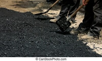 Workers Stack Asphalt on the Road. - People in muddy boots...