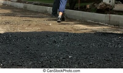 Road Construction and Repairing Works - Worker with shovel...