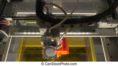 Head of 3D printer in action - Electronic three dimensional...