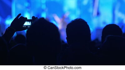 People takes photos on night concert