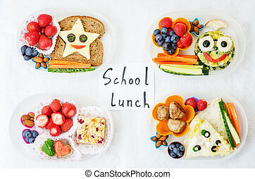 school lunch boxes for kids with food in the form of funny...