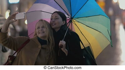 Two girls makes selfie on rainy day