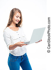 Woman standing and using laptop - Happy casual woman...