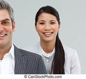 Attractive business associates standing in a line in front of the camera