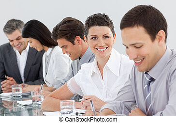 International business people taking notes in a meeting -...