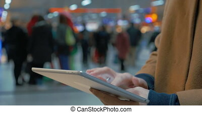 Woman Writing on Tablet PC
