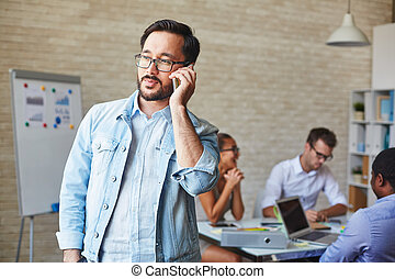Calling in working environment - Asian businessman in...