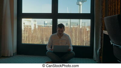 Being Always in Touch with Laptop Webcamera - Young man is...