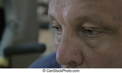 Mature man in a sweat after training - Slow motion close-up...