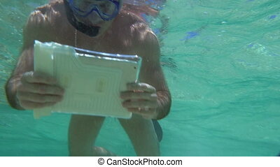 Man Shooting Coral Reef with Tablet PC - Slow motion shoot...