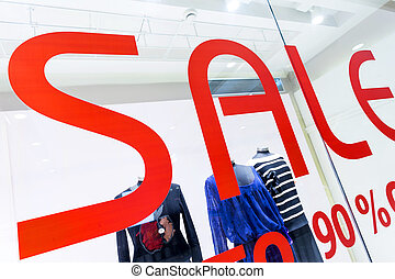 sale word with shop window