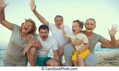 Big happy family waving hands at the seaside - Slow motion...