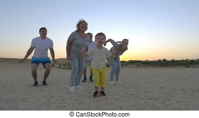 Happy jump of big family with child