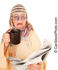 Crazy new age woman in a yellow robe with coffee cup and...