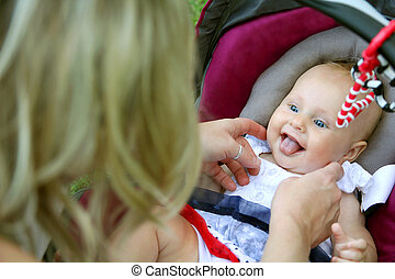 Laughing Newborn Baby Girl in Car Seat - A beautiful newborn...