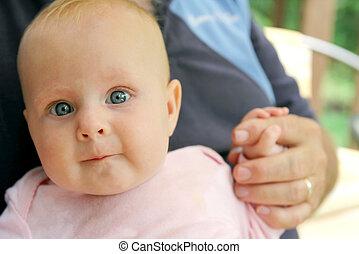 Newborn Baby Girl Holding Grandpa's Hand - A newborn baby...