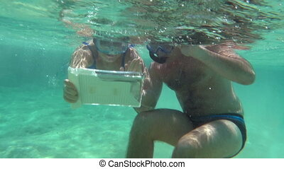 Young Couple Making Selfie Underwater - Slow motion shot of...