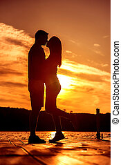 Couple Love Embrace, silhouette at sunrise