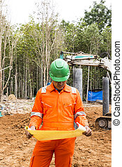 Thai construction site worker wearing high visibility safety...