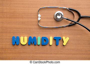 Humidity colorful word with stethoscope on the wooden...