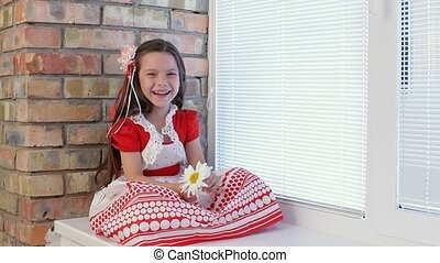 At the Window Sits a Girl Smelling a Daisy and Laughs.