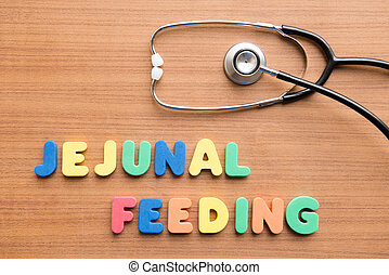 Jejunal feeding colorful word with stethoscope on the wooden...