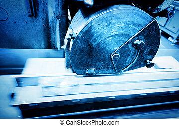 Big metal saw at work in workshop. Industrial