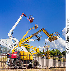 Several various self propelled articulated boom lift and...