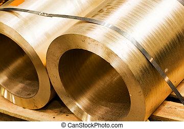 Industrial hardened steel cylinders in workshop Industry -...
