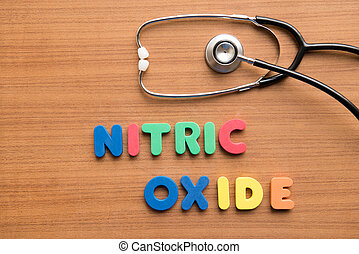 Nitric oxide colorful word with stethoscope on the wooden...