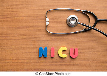 NICU colorful word with stethoscope on the wooden background